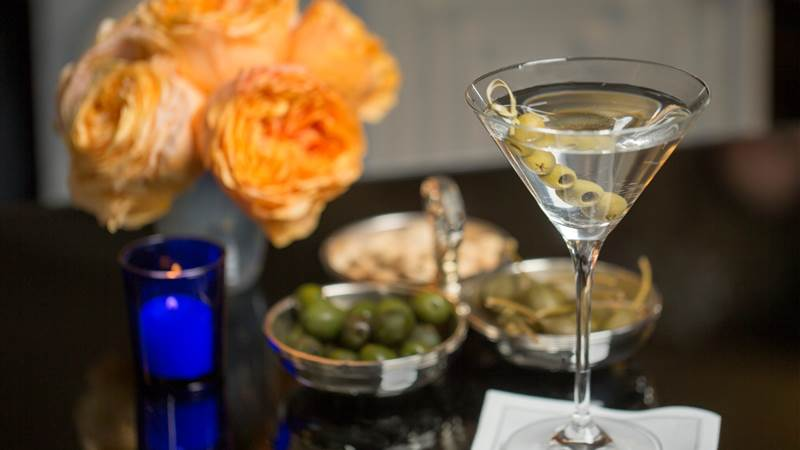 A Martini with olives in a Midtown Manhattan Restaurant